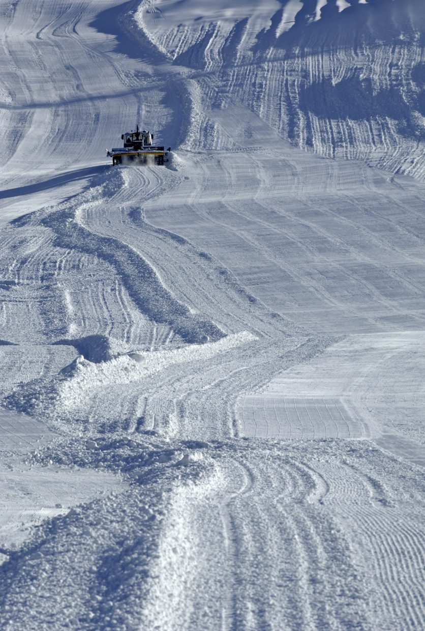 A groomer puts down some corduroy on lower See Me as the ski area prepares for Scholarship day on today.