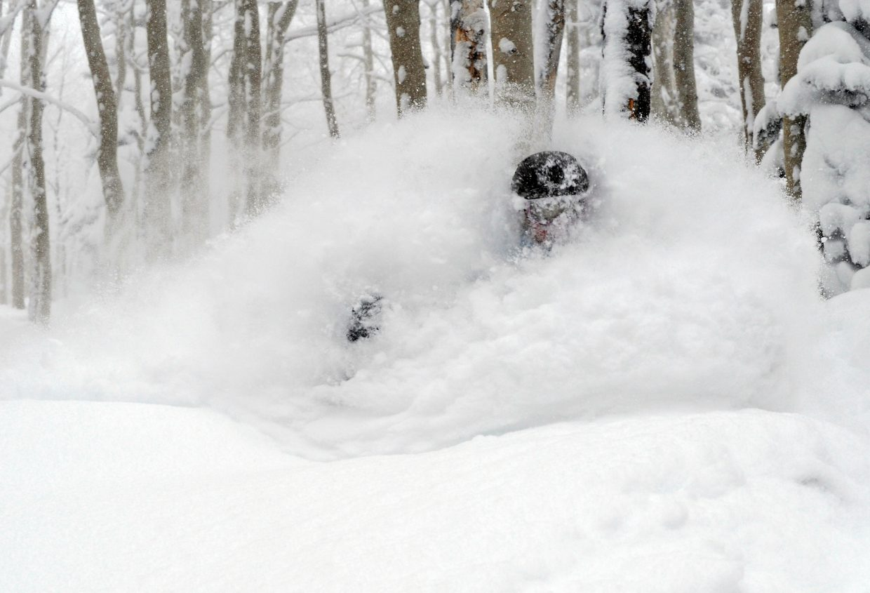 Steamboat local Cathy Weidemer wishes she brought a snorkel. An overnight storm dropped 27 inches of fresh, light and dry powder. Steamboat enjoyed its biggest single-day snowfall total and the most snowfall in the state. More snow is forecast throughout the week. Photo/Larry Pierce