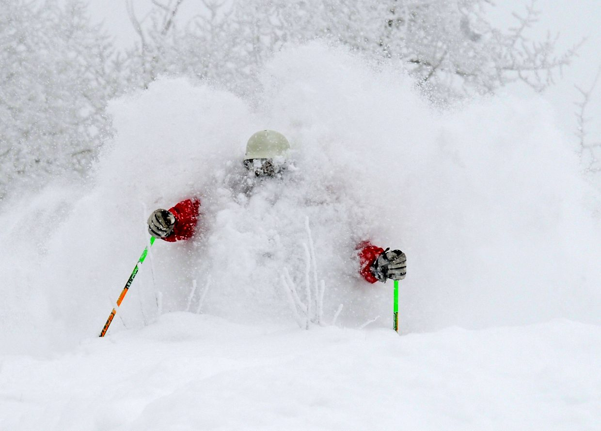 With 27 inches of fresh powder dumped on the ski resort this morning, hooting and hollering was heard all over the mountain. Skier Joe Kelly finds it hard to see or breathe on the way down Ted's Ridge. Photo/Larry Pierce