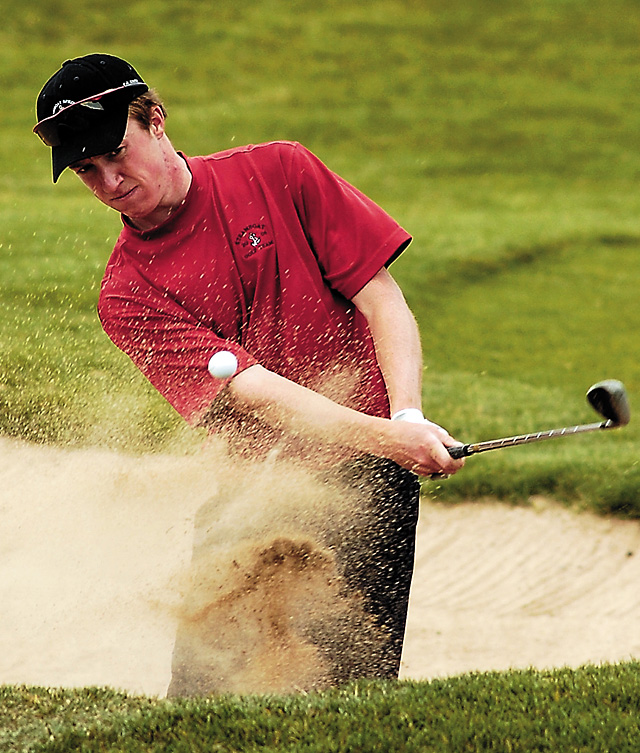 Steamboat Springs golfer Paul Berry chips out of the sand trap during the class 4A state high school golf championships Monday. Berry shot a 75 in the tournament, which was held at the Haymaker Golf Course in Steamboat.