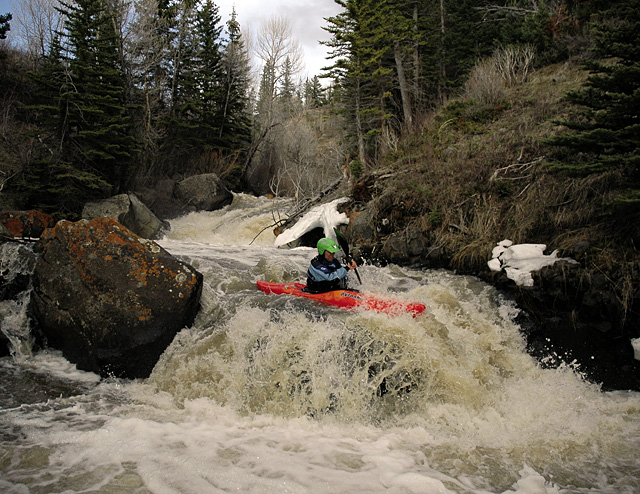Joe Carberry takes the first strokes down an unnamed Class V rapid beneath A.C. Slater Falls on Slater Creek of the Little Snake River.