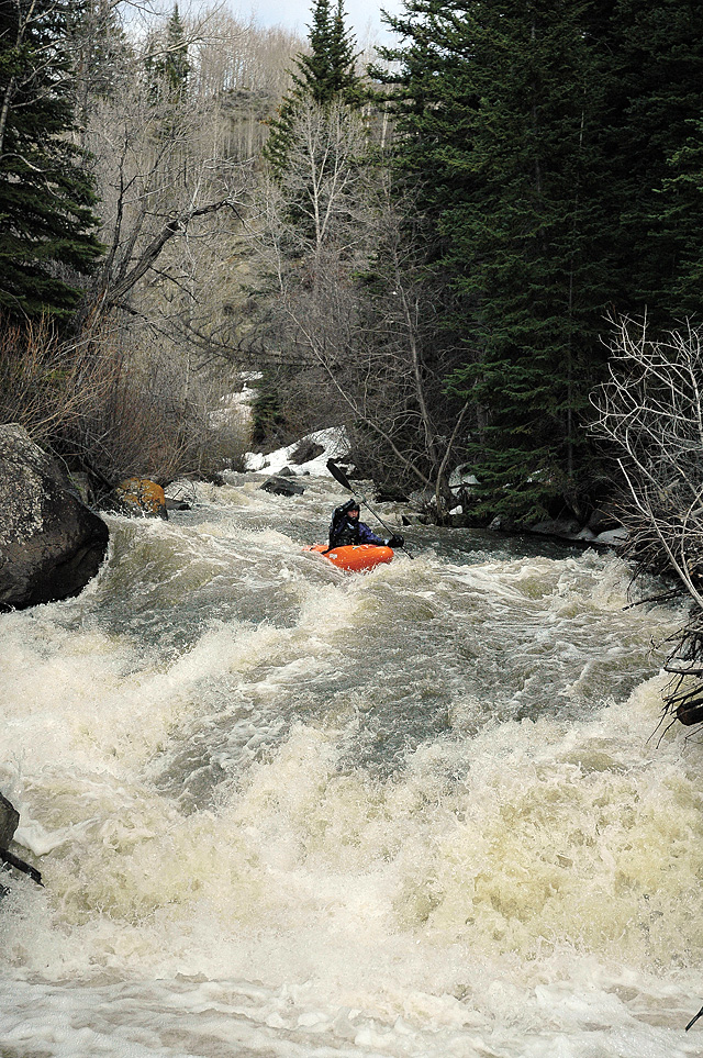 Nick Hinds takes the first strokes down an unnamed Class V rapid beneath A.C. Slater Falls on Slater Creek of the Little Snake River.