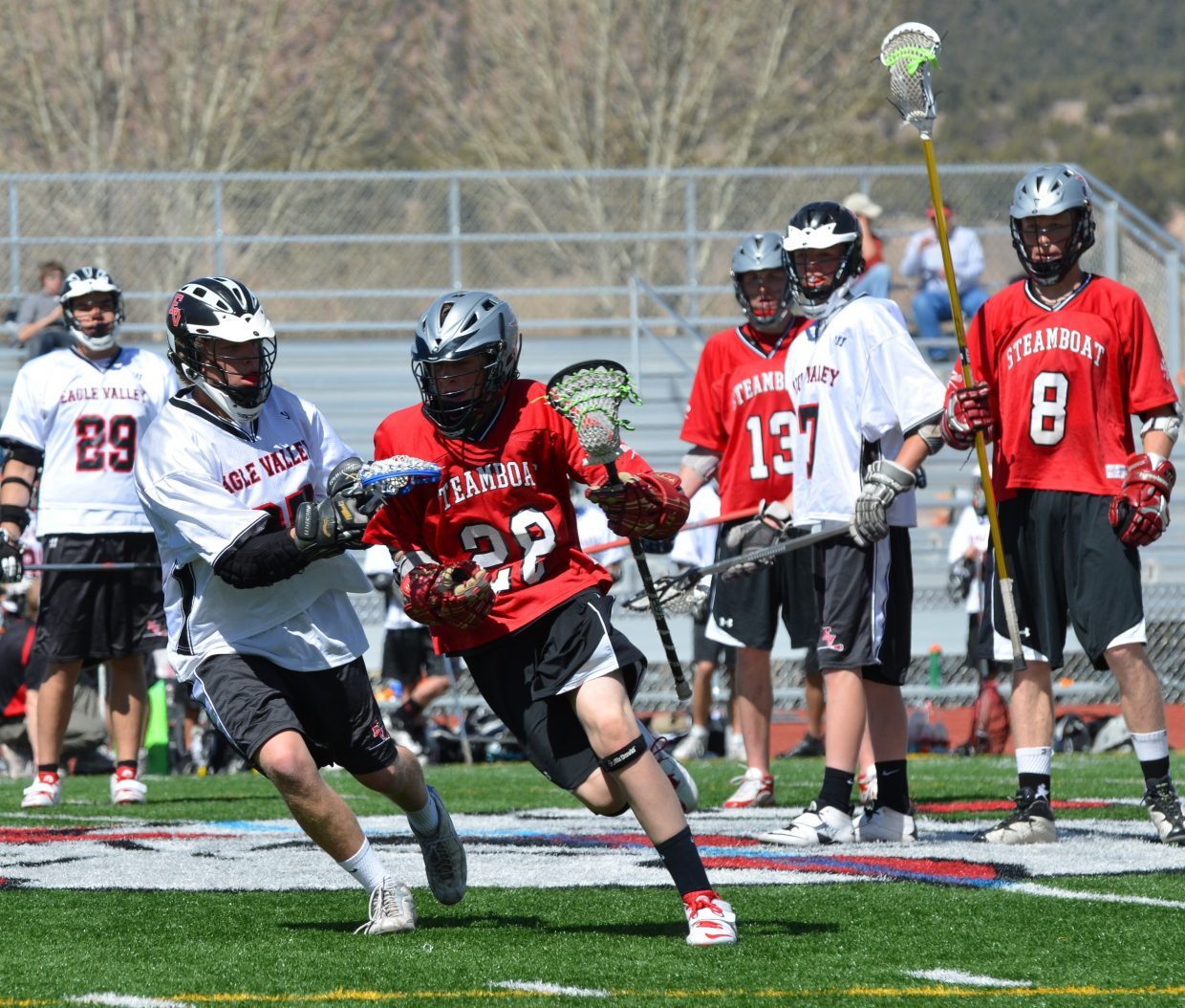 Steamboat lacrosse player Eric Sobeck gets the pass and heads downfield against Eagle Valley on Saturday.