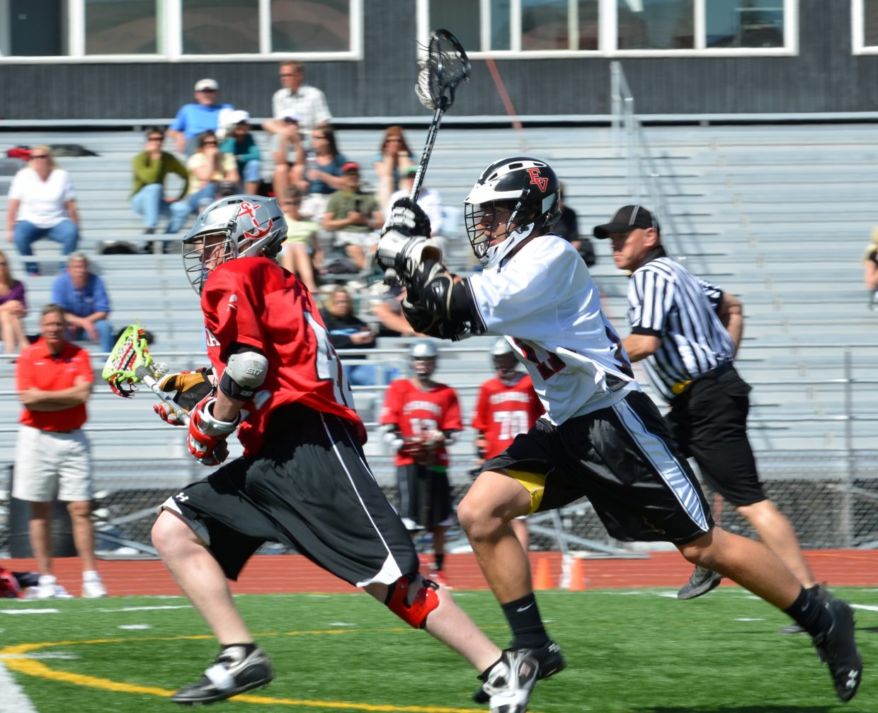 Steamboat lacrosse player Brad Ryan avoids the defender and heads downfield.