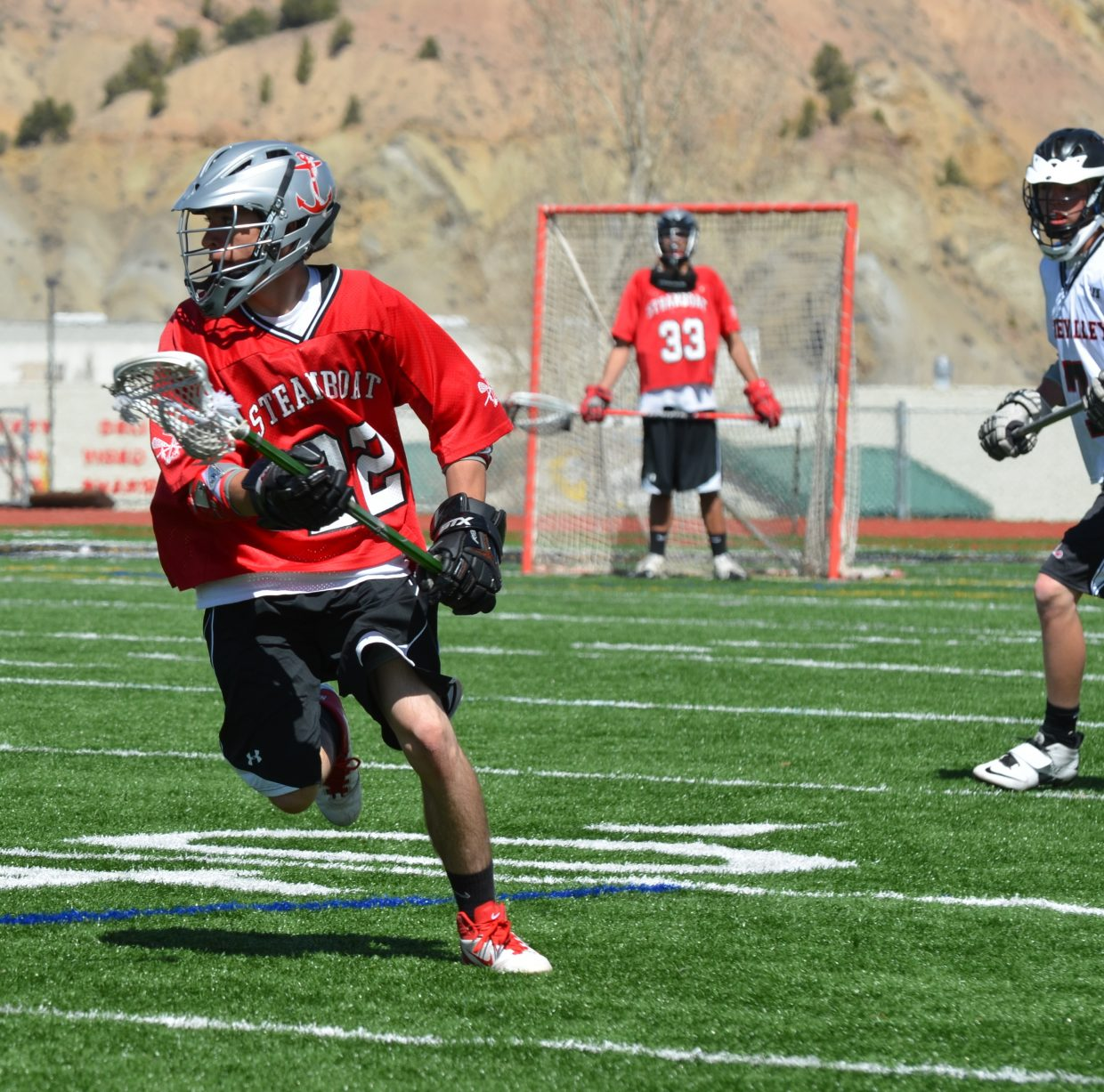 Lacrosse player Aaron Higgins looks to head into the offensive zone.