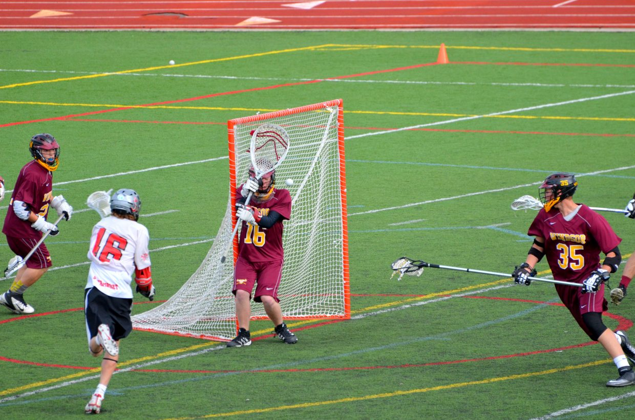 Peter White shoots and scores against the Windsor goalie.