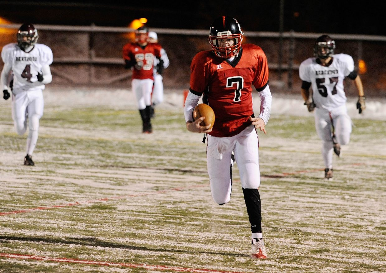 Steamboat Springs High School senior Austin Hinder runs the ball during the second half.