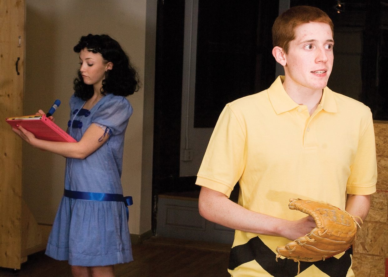 """Charlie Brown, played by Sean Hill, faces tough questions from Lucy, played by Matthia Duryea, while rehearsing a scene for """"You're a Good Man, Charlie Brown."""" The production will take center stage at 7 p.m. Thursday and April 10, and 2 p.m. April 11 at the Steamboat Springs High School."""