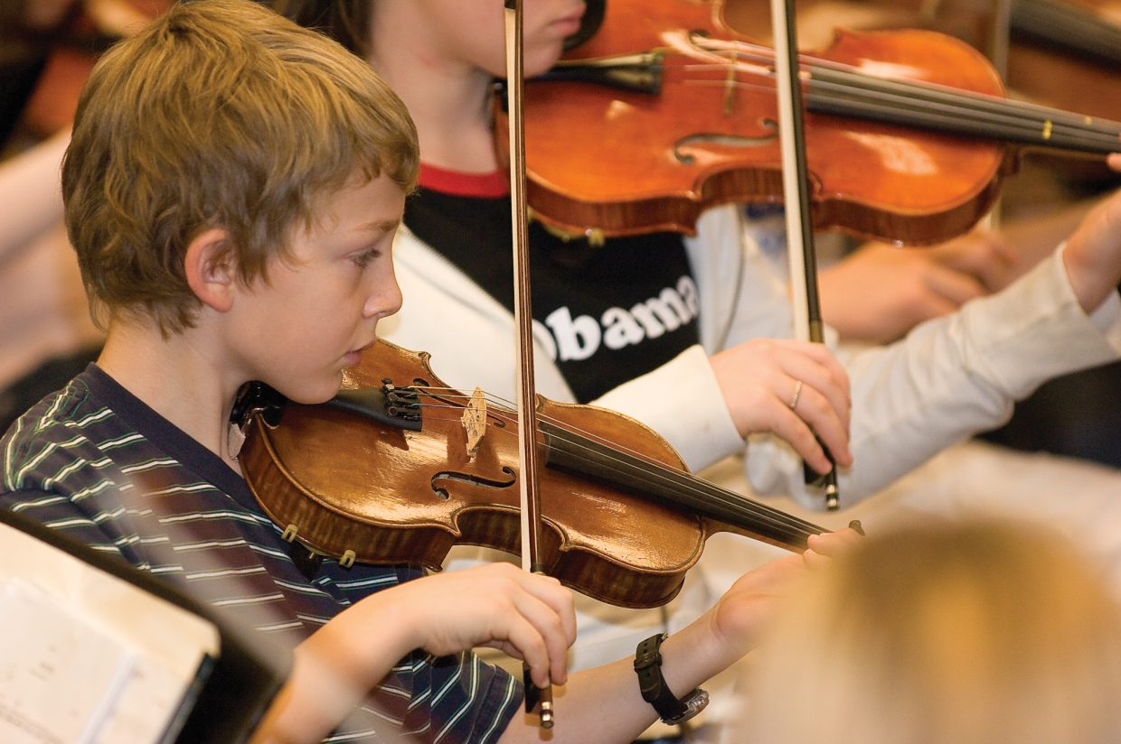 Violinist Zach Cohn practices with the Steamboat Springs Youth Orchestra last week.