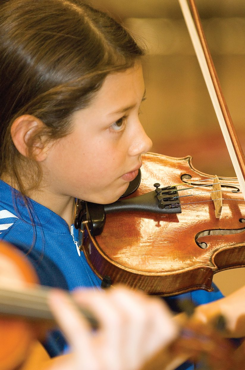 Violinist Kristina Greenwood plays with the Steamboat Springs Youth Orchestra during a rehearsal at Steamboat Springs High School.