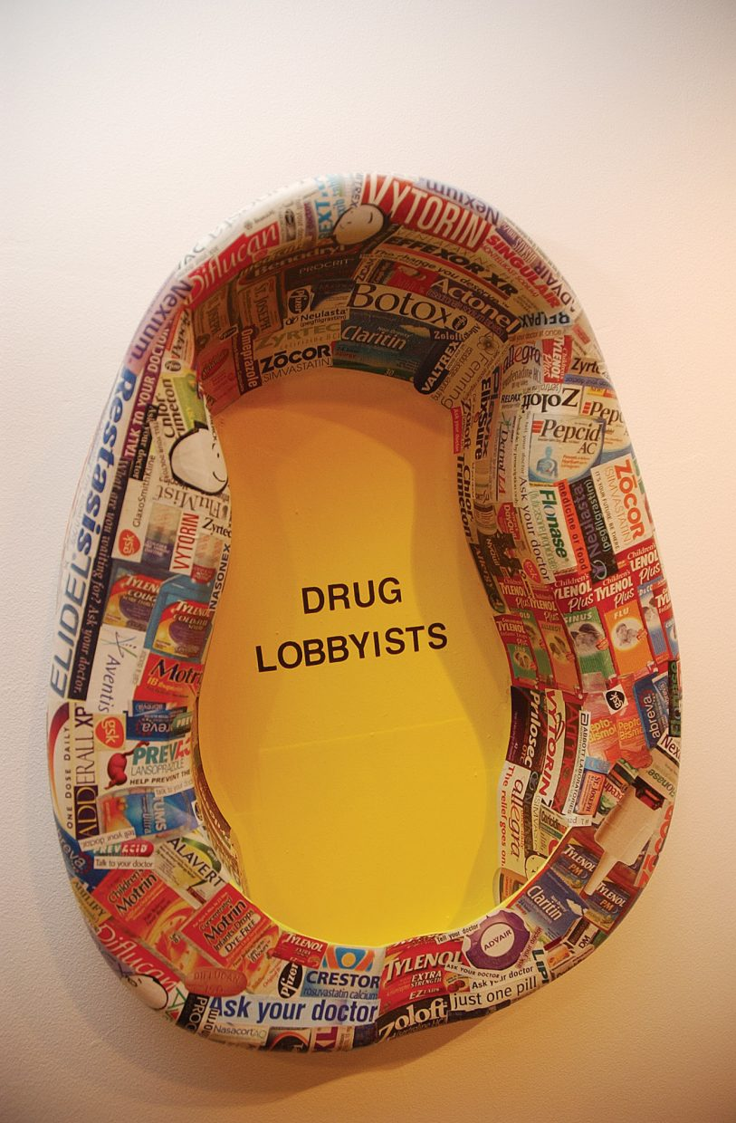 Joel Allen uses a bedpan wrapped in pharmaceutical company advertisements to illustrate his feelings with the industry.