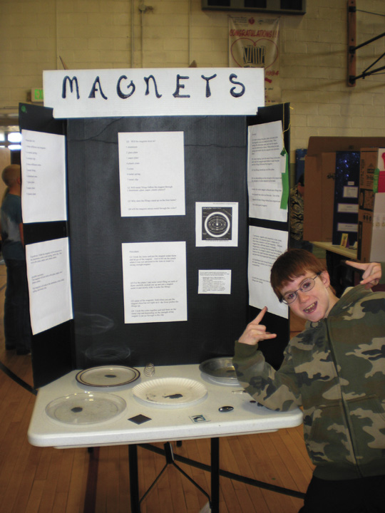 South Routt Elementary School fifth-grader Shad Covalt celebrates the completion of his science project about magnets.