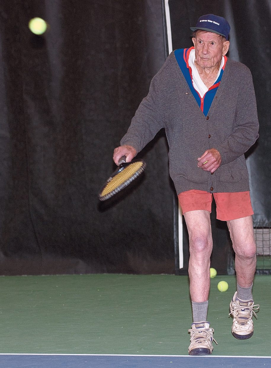 John Fetcher, 96, returns a volley during a match Friday afternoon at the Tennis Center at Steamboat Springs. Fetcher plays tennis twice a week with a group of seniors who have made tennis a part of their daily routine.