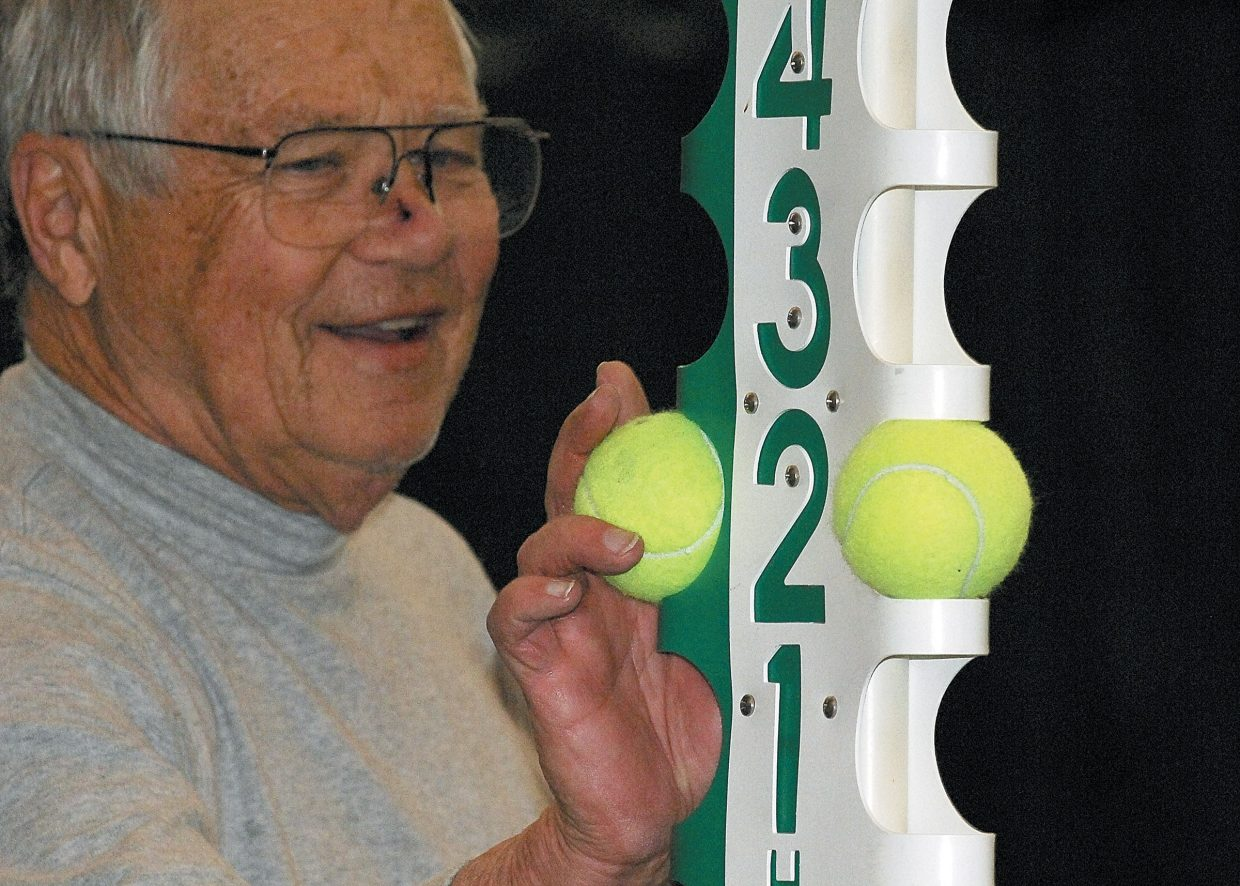 Dave Zabel, 72, changes the score during a match this week at the Tennis Center at Steamboat Springs.