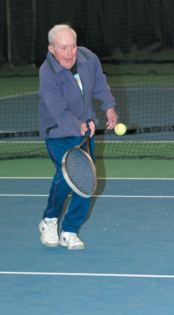 Stan Whittemore returns a volley during a match last week at the Tennis Center at Steamboat Springs. Whittemore, who will turn 90 in June, is part of a group of seniors who play every weekday afternoon.