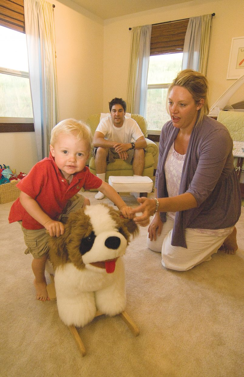 Cole Murphy and his mom, Stephani, and dad, Matt, relax inside his family's Red Hawk Village home in Stagecoach.