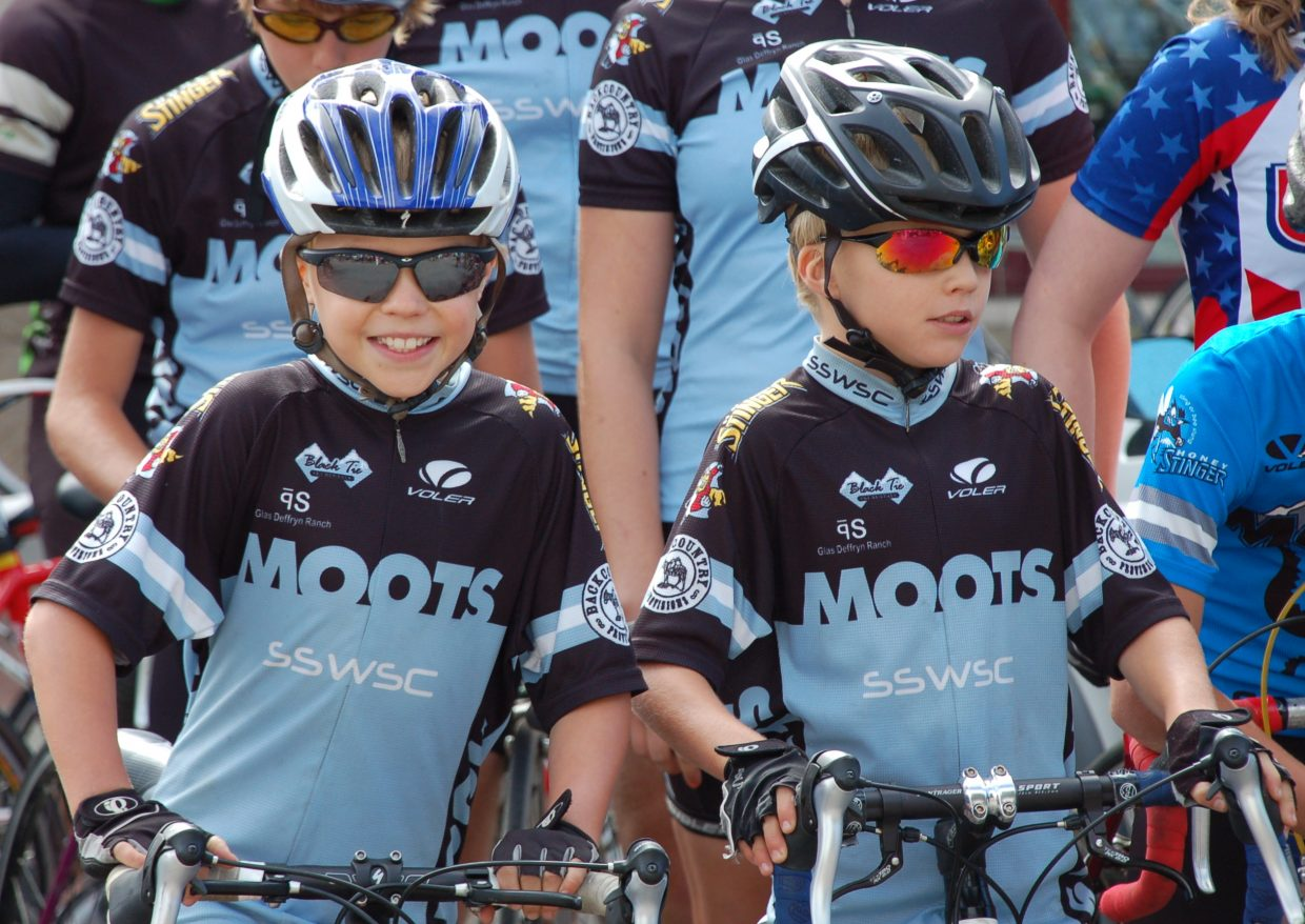 The Seymour boys get ready to participate in the community bike ride with cyclist Andy Schleck on Monday.