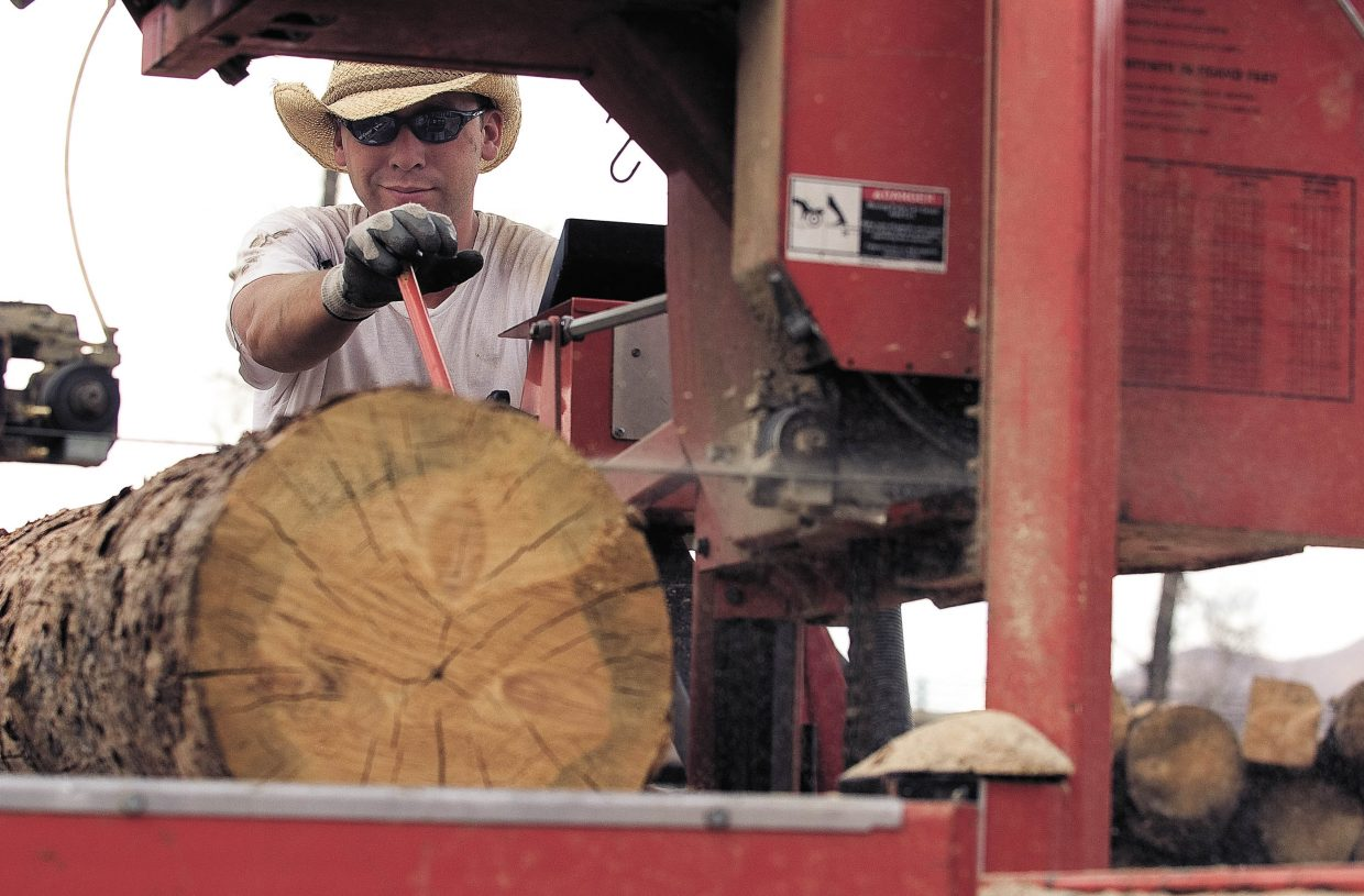 Joe Redfern, of J Bonn Wood Products, cuts a log into pieces of lumber at the Steamboat Springs sawmill. The lumber will be used in the construction of homes in the Steamboat area.