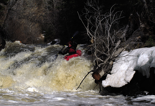 Steamboat kayaker Adam Mayo runs an unnamed Class V rapid on Slater Creek beneath A.C. Slater Falls on Friday afternoon.