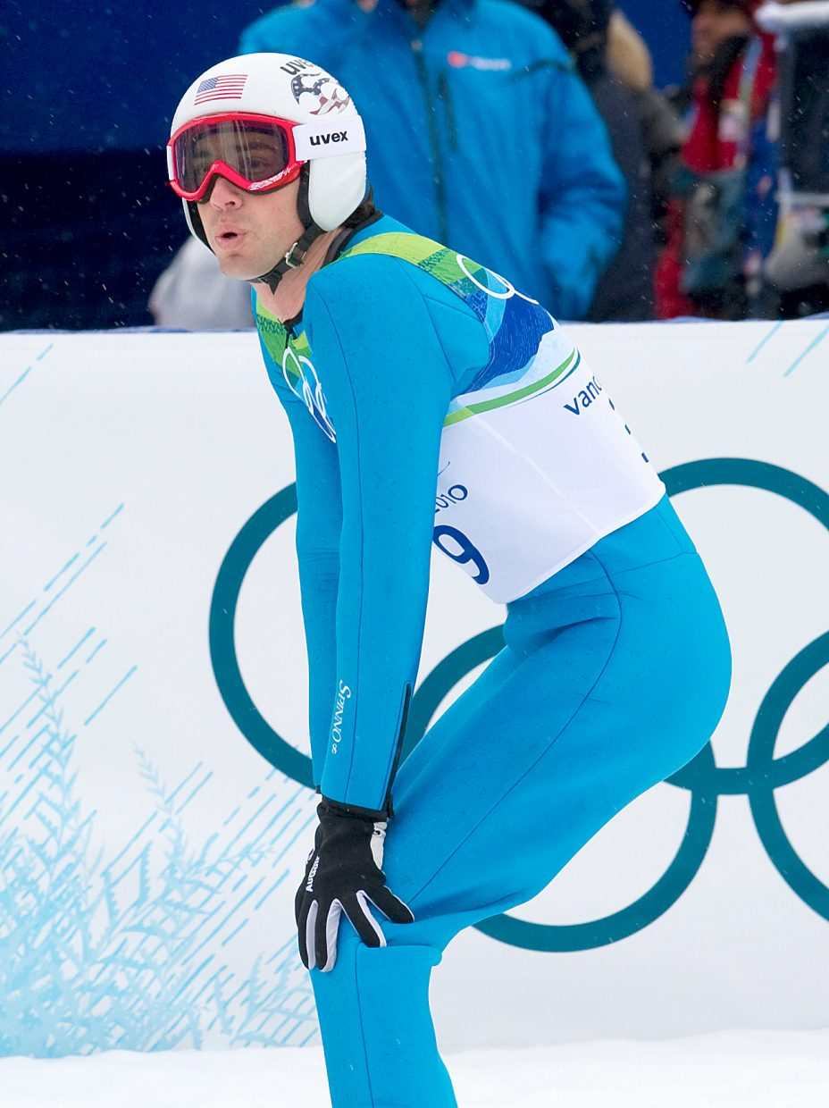 Steamboat Springs' Johnny Spillane looks at the scoreboard to see where he stands after jumping in Thursday's large hill Nordic combined event at Whistler Olympic Park.