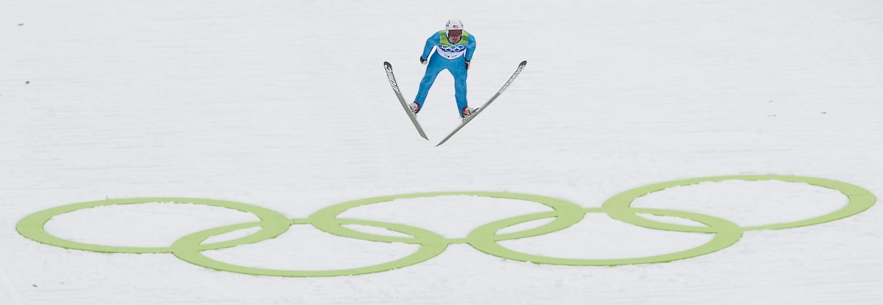 Johnny Spillane flies past the Olympic rings or his way to Olympic silver in Nordic combined event at Whistler Olympic Park.