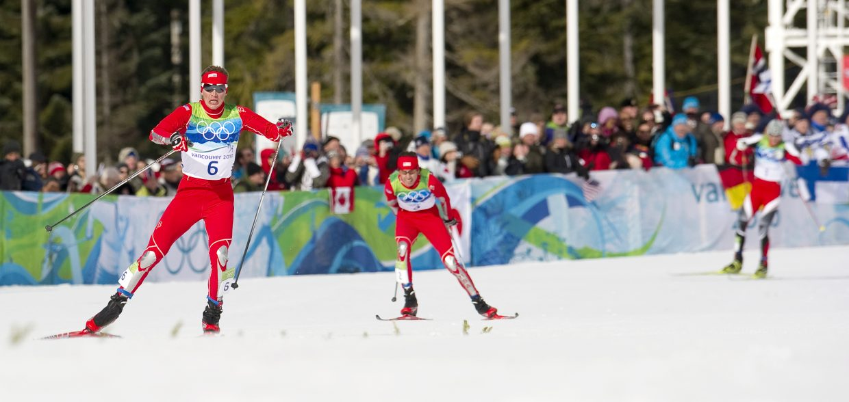U.S. Nordic combined skier Billy Demong leads the way toward the finish line in large hill individual Gundersen event in 2010. He was followed by teammate Johnny Spillane in second place and Austria's Bernhard Gruber in third.