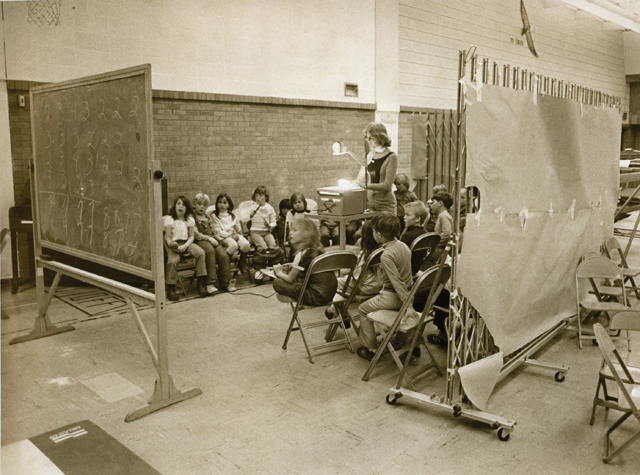 A makeshift classroom is set up in the Soda Creek gymnasium because the student population in 1979 was too large to accommodate the structure.