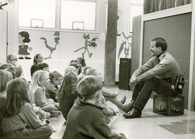 Current Steamboat Springs Director of Public Safety, J.D. Hays, talks with Soda Creek students March 25, 1993. Hays was Steamboat Springs Police Department Captain at the time.