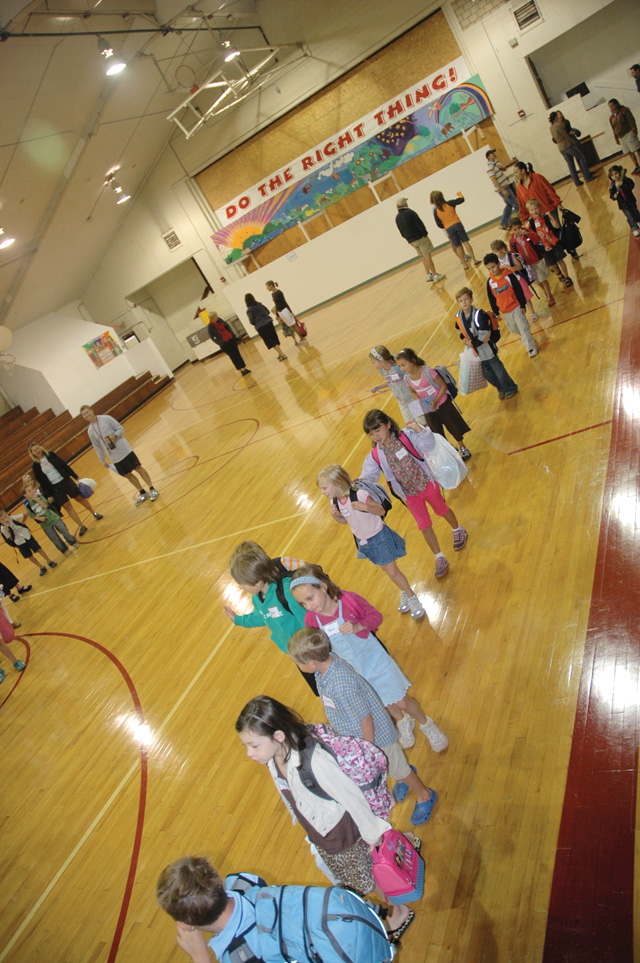 Soda Creek Elementary School students gather in the gymnasium at the George P. Sauer Human Services Center Monday before being escorted to their temporary mobile classrooms on the first day of school.