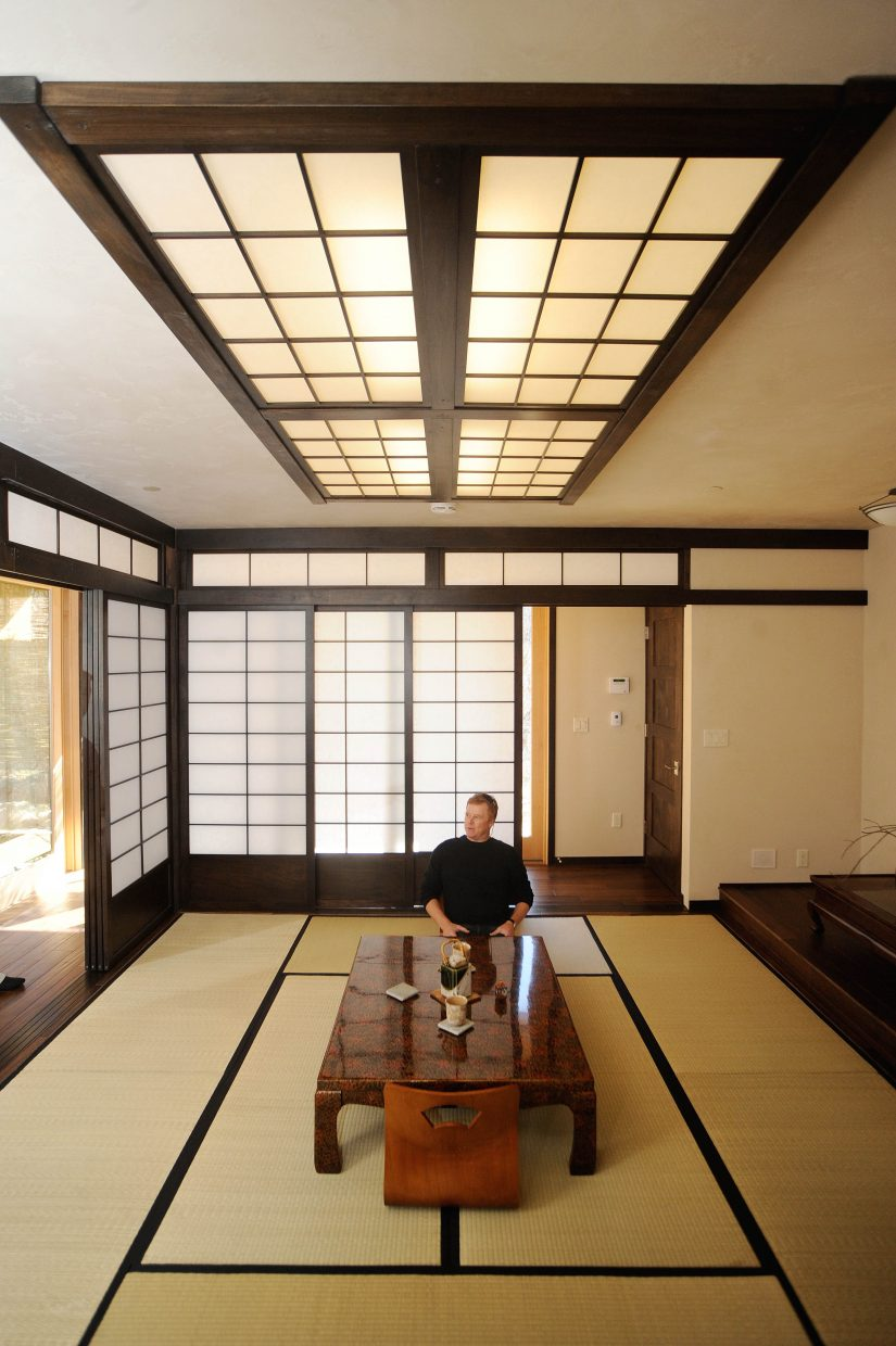 Architect Michael Rath sits at a table in the Japanese tea house in back of the main house.
