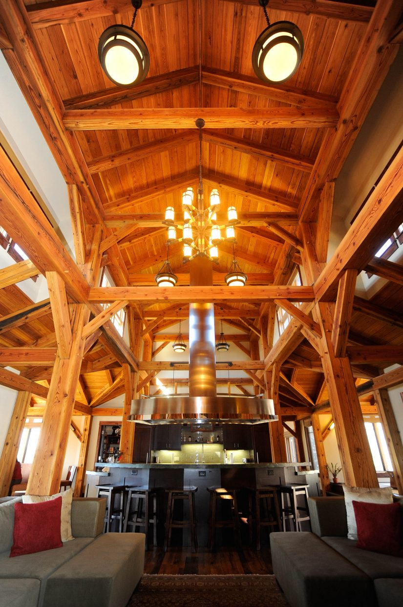 Reclaimed timber is a focal point in the large open entertaining area off the kitchen.