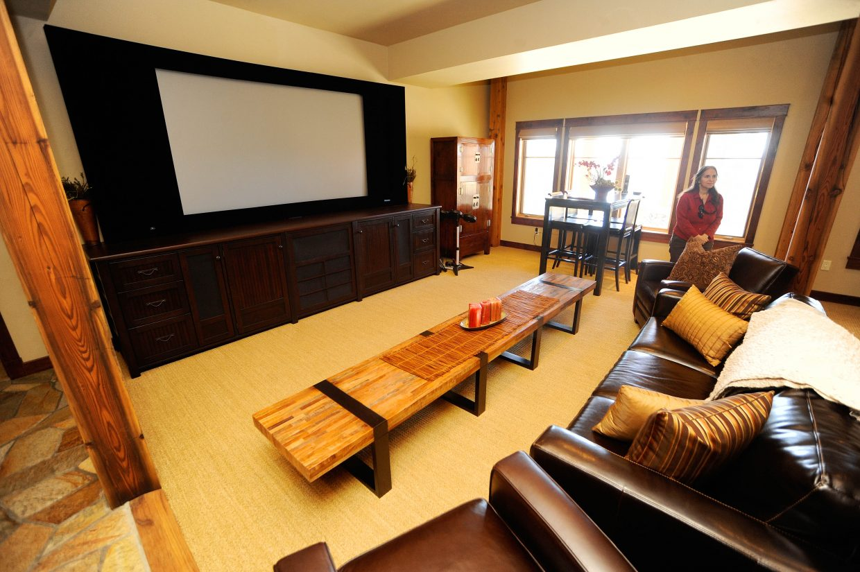 A large entertainment room with a 110-inch screen is on the first level of the home.