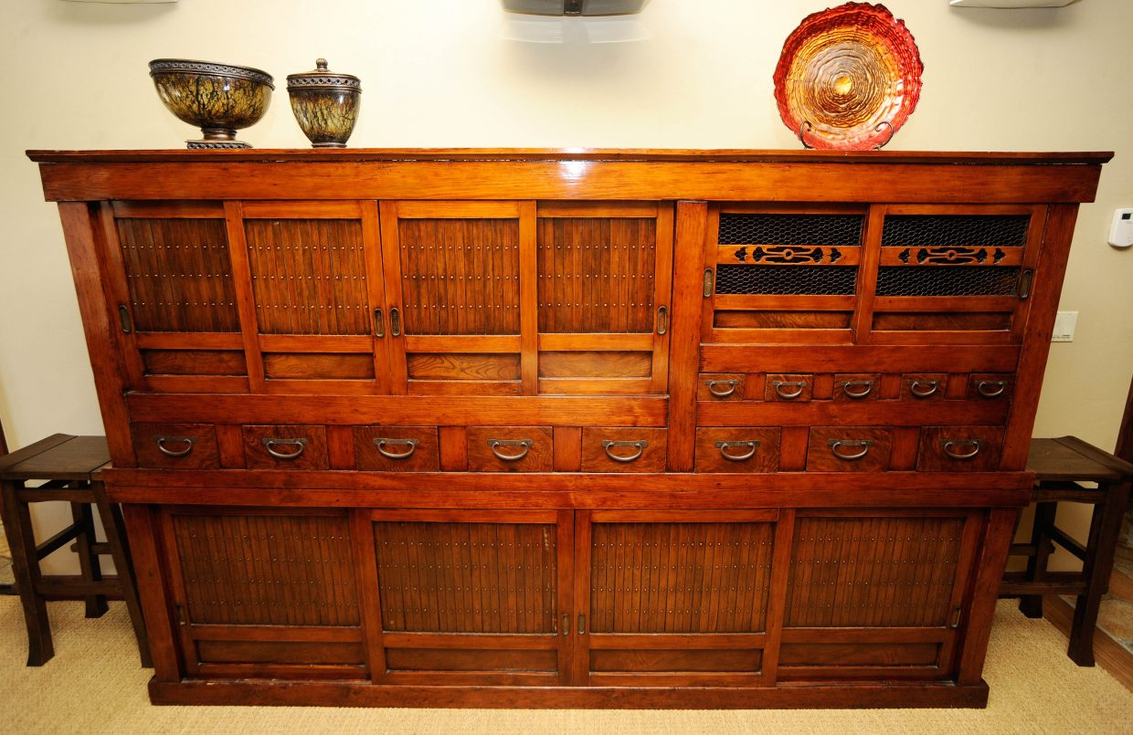 A Japanese tansu, or antique chest of drawers, from the mid-19th century sits in the entertainment room on the first level.