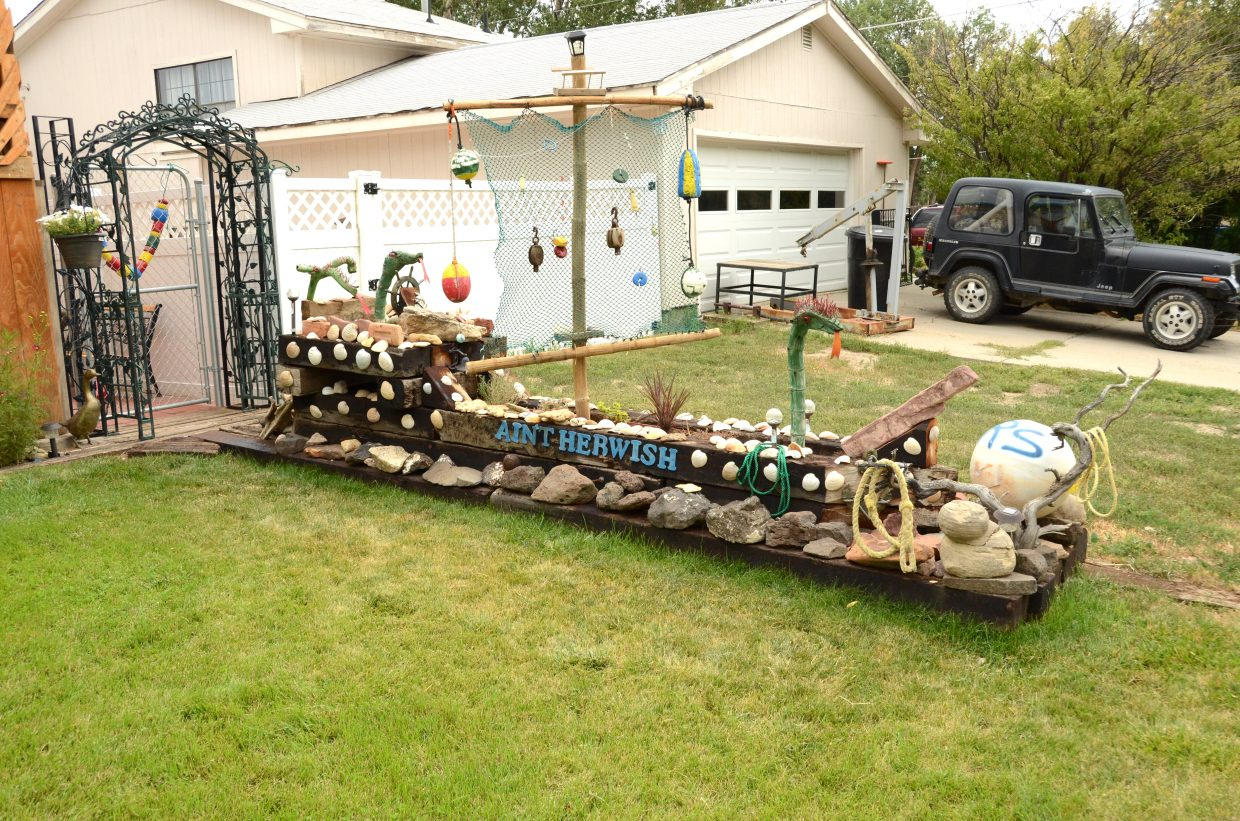 This lawn decoration, which stands at 315 Apple St., was created by Mike Lavick for his sister, Ruth Sanchez. The ship was built using spare wood and materials Sanchez found while on vacation at South Padre Island, including seashells, coral and a variety of items washed up on the beach shore. The sea serpents and mast are made from bamboo.
