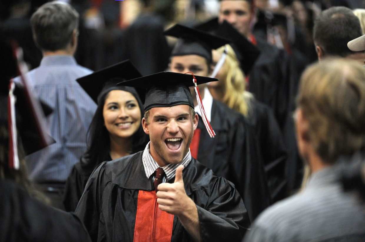 Tyler Samlowski gives a thumbs up at the beginning of Saturday's Steamboat Springs High School graduation.