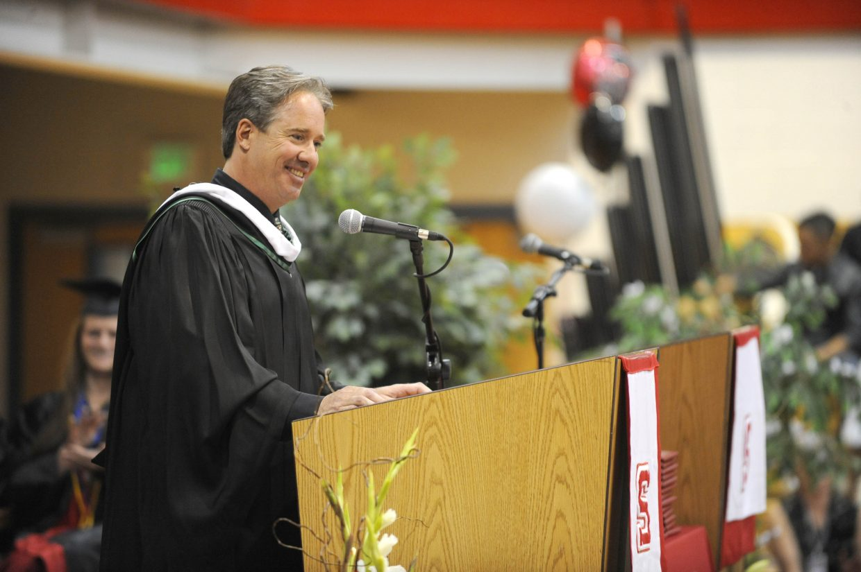 Johnny B Good's Diner owner Mike Diemer delivers the commencement speech during Saturday's Steamboat Springs High School graduation.