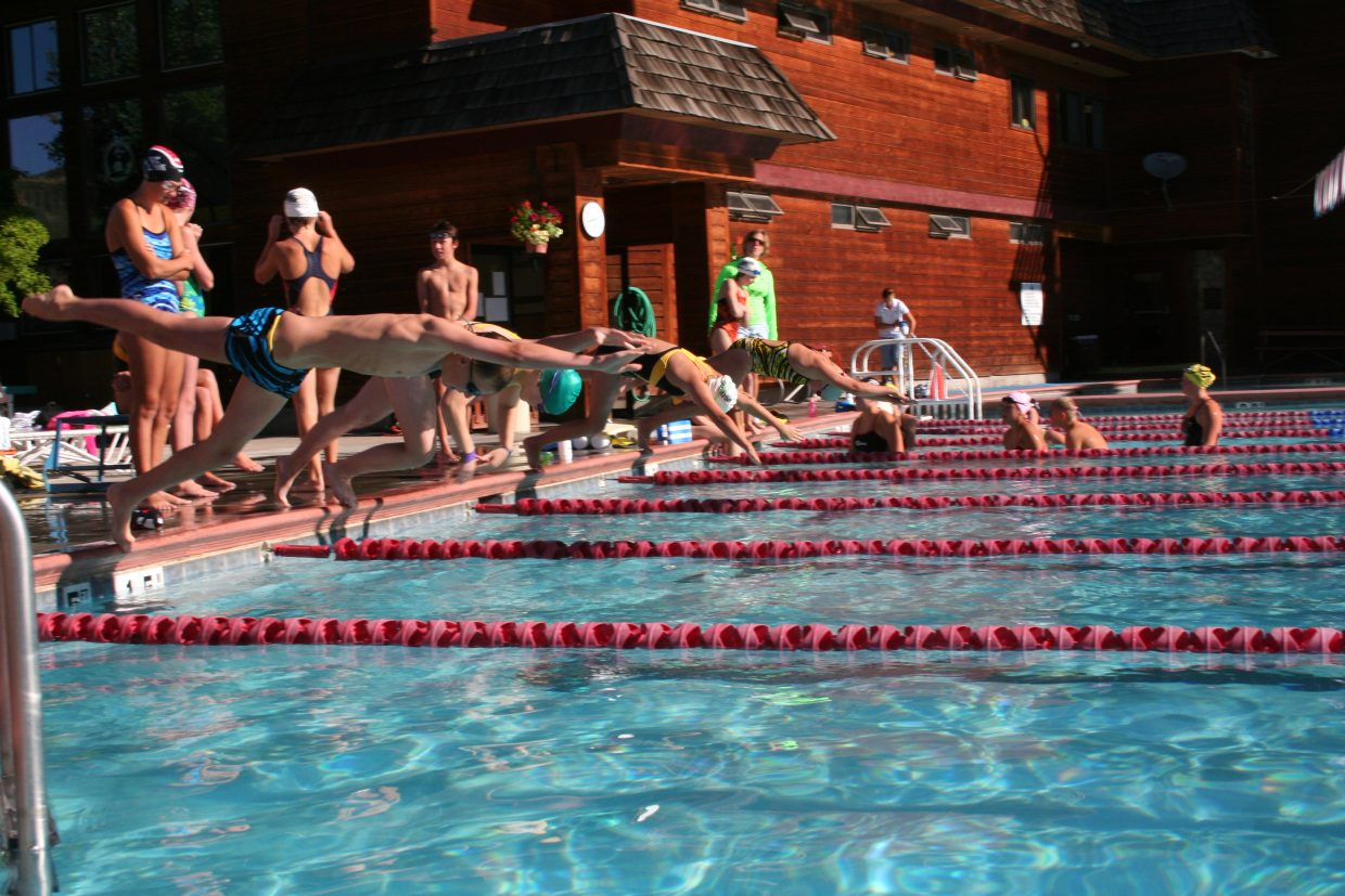 The Steamboat Springs Swim Team dives into the pool at Old Town Hot Springs. Thirty-six swimmers qualified for the Western Slope Championships this weekend in Grand Junction. The meet will be held at Colorado Mesa University. It begins Friday and runs through Sunday.