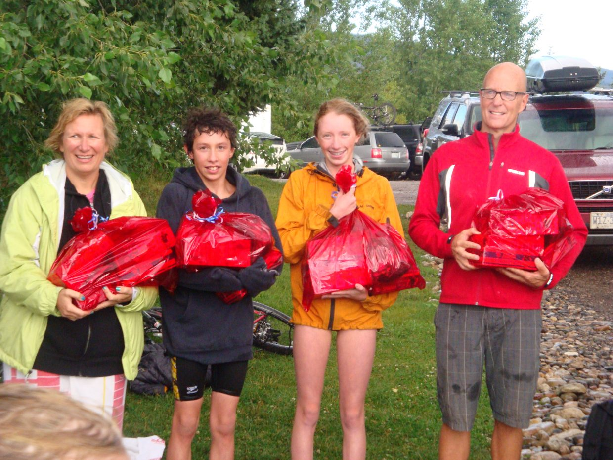 The winners of the Bald Eagle Lake Open Water Swim Series celebrate after Monday's finale. Ruth Abate, from left, Tyler Terranova, Samantha Terranova and Scott Weir were crowned champions.