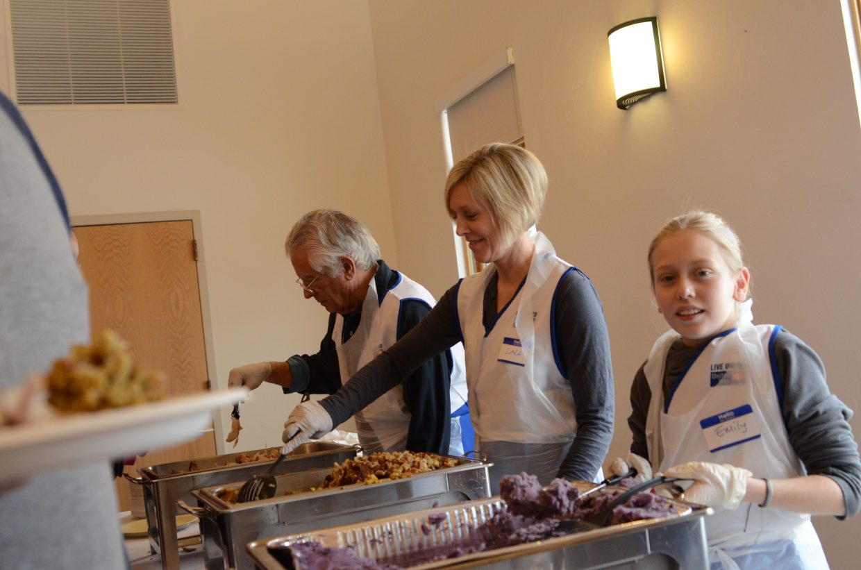 Volunteers offer donated food to community members for Routt County United Way's annual Community Thanksgiving Dinner.