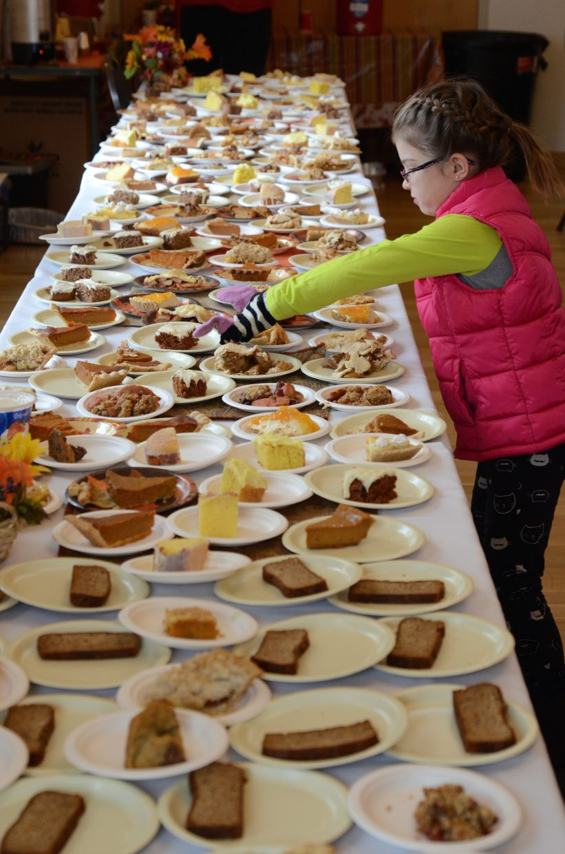 Sofia Scherff picks out one the many delicious desserts available at Routt County United Way's annual Community Thanksgiving Dinner.
