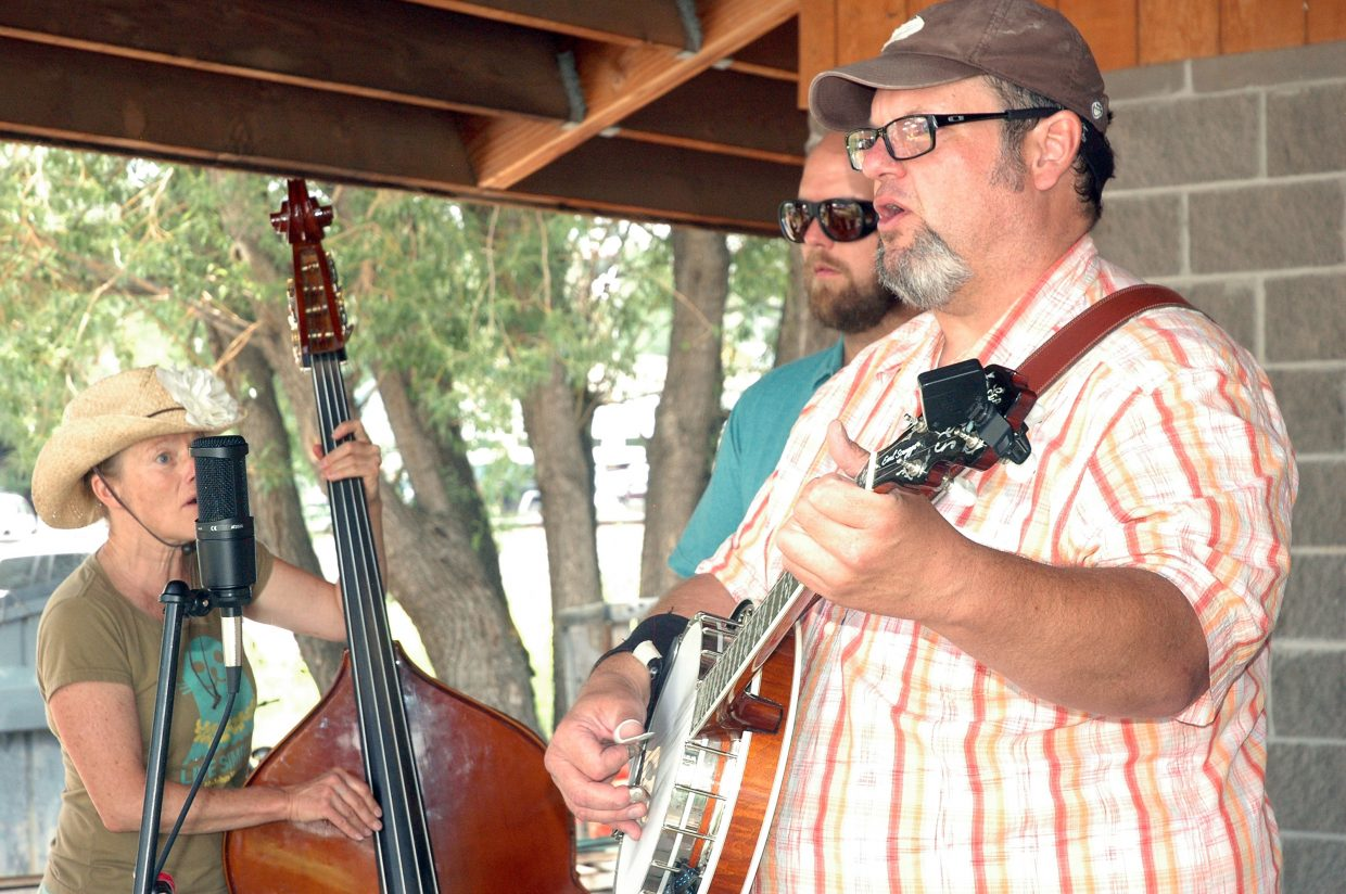 Scott Kirton, right, and members of bluegrass band Old River Road played for the crowds at Saturday's Taste of South Routt festival in Oak Creek.