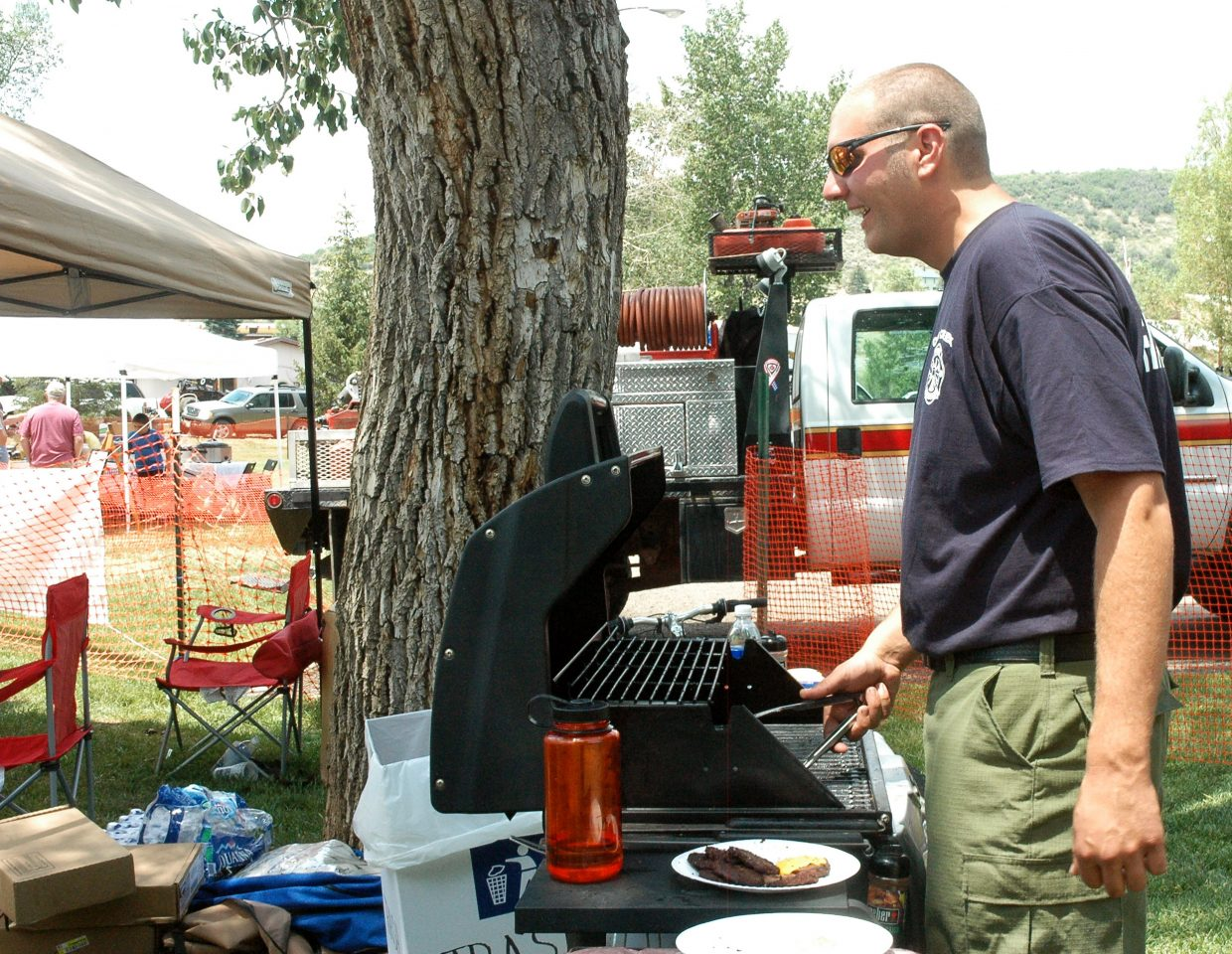 Jeff Buffetti of Oak Creek Fire Rescue works the grill at the fire department's tent during the annual Taste of South Routt festival in Oak Creek on Saturday.