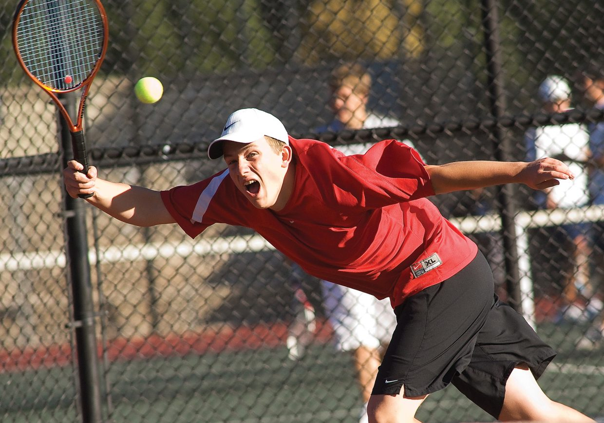 Steamboat Springs' Vladan Chase returns a volley against Kent Denver's No. 4 doubles team during a match Friday morning at Pueblo City Park during the State High School Tennis Championships.