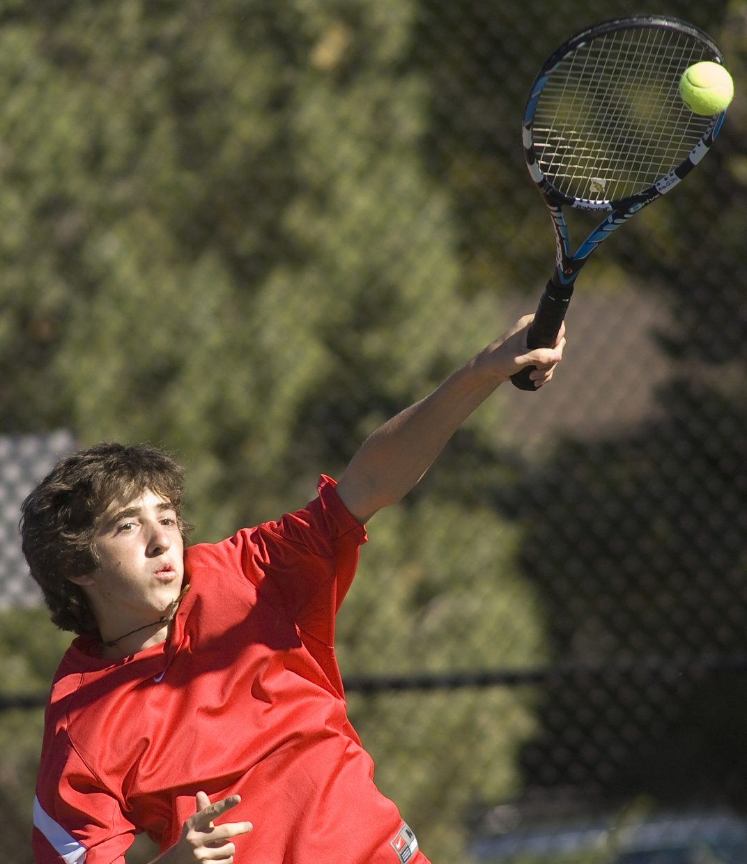Steamboat Springs' Alex Gibbs smashes the ball in a match against Fountain Valley during Friday's state high school tennis championships.
