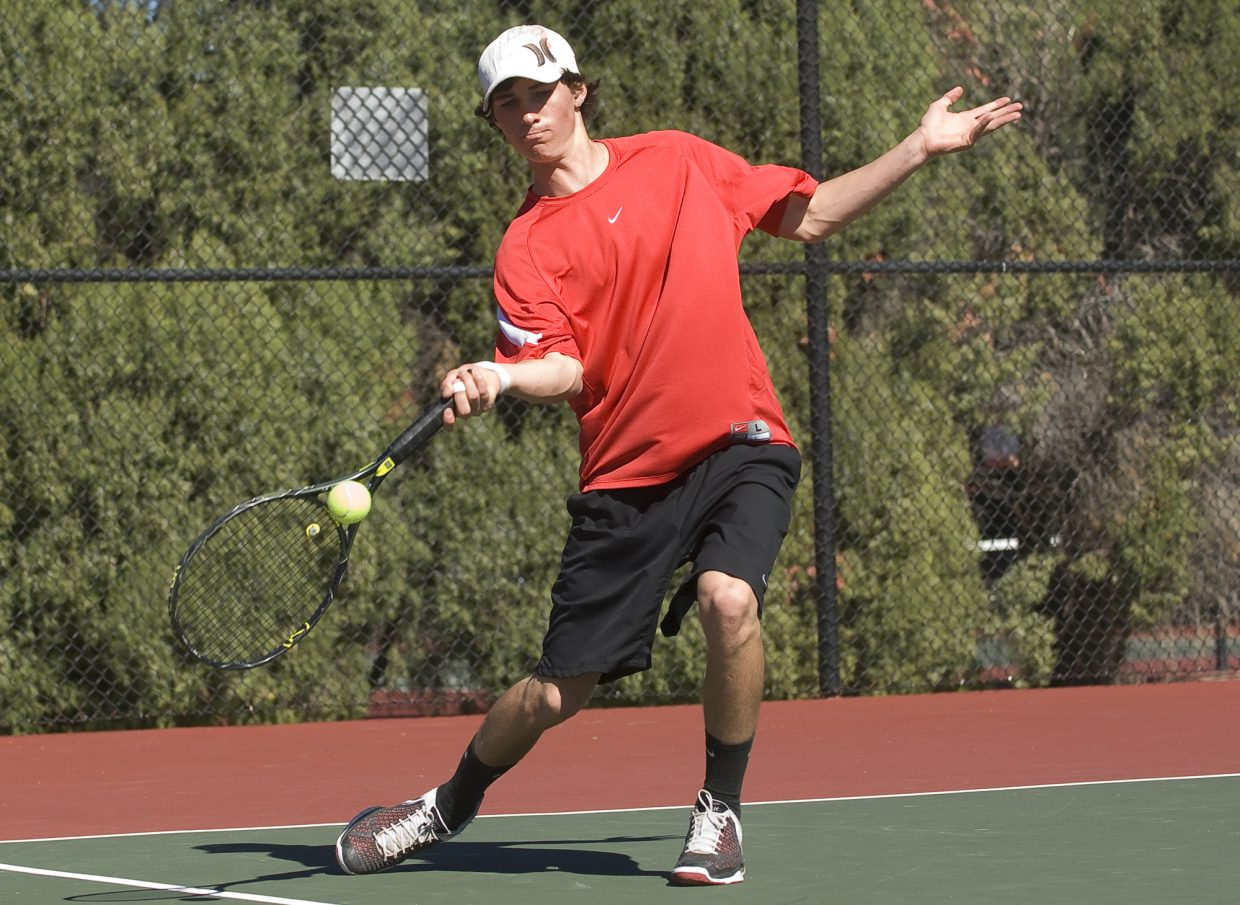 Steamboat Springs' senior Charlie Smith returns a volley in a match against Longmont's No.1 doubles team Friday afternoon at the State High School Tennis Championship in Pueblo. Smith and partner Jack Burger won the match earning the right to play for third place in today's finals.
