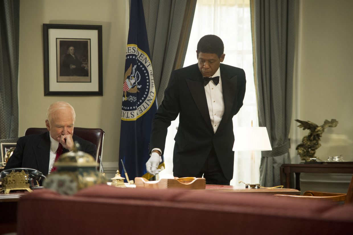 """Cecil Gaines (Forest Whitaker) oversees domestic duties in the Oval Office while President Dwight D. Eisenhower (Robin Williams) makes a difficult decision in """"The Butler."""" The movie is a true story about one man's experiences working in the White House from the 1950s to '80s."""