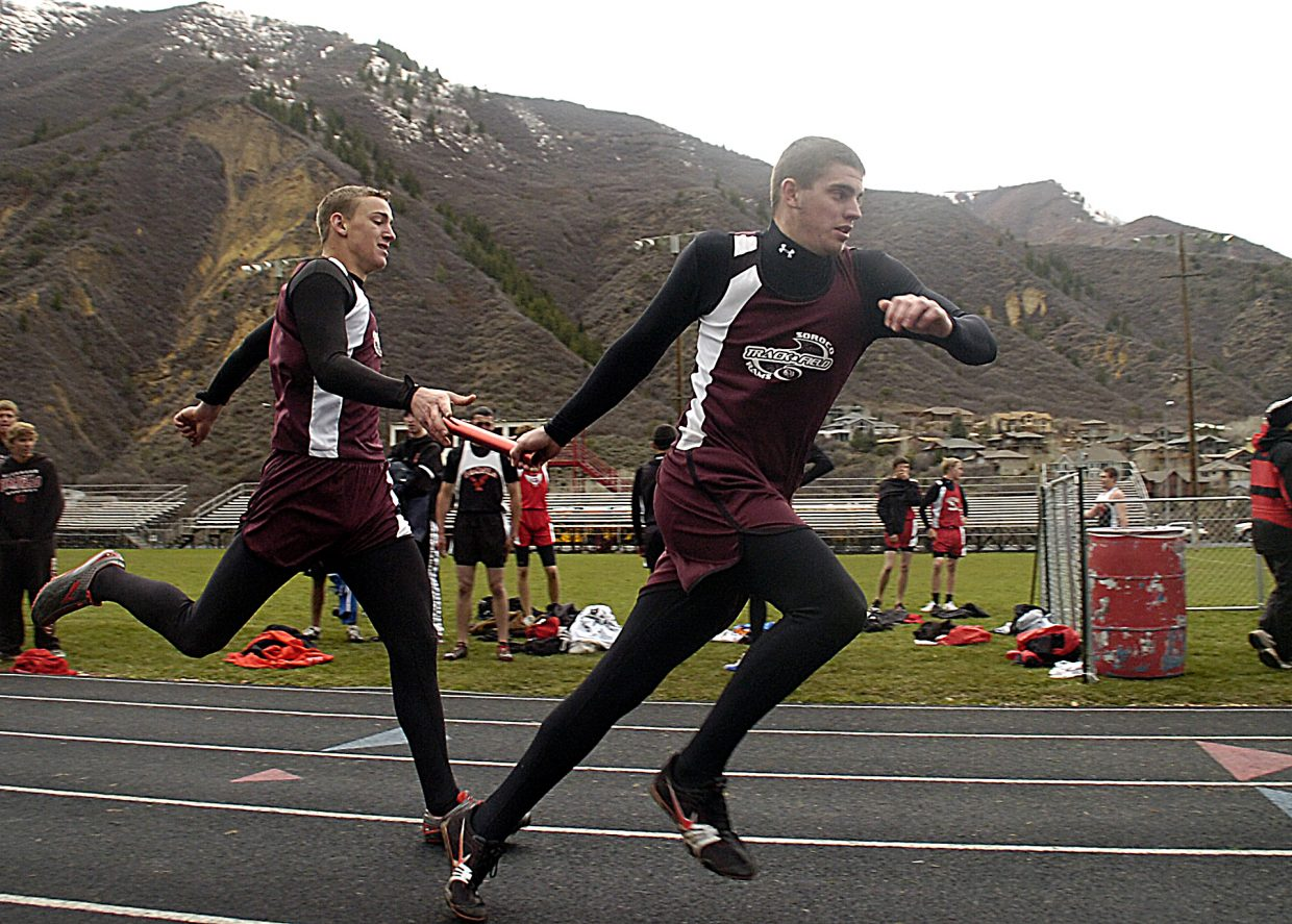 Soroco High School senior Ryan Tibbetts takes the baton from junior Cody Miles during the 1,600-meter relay Saturday at the Demon Invitational track meet in Glenwood Springs. Soroco finished fourth in the race.