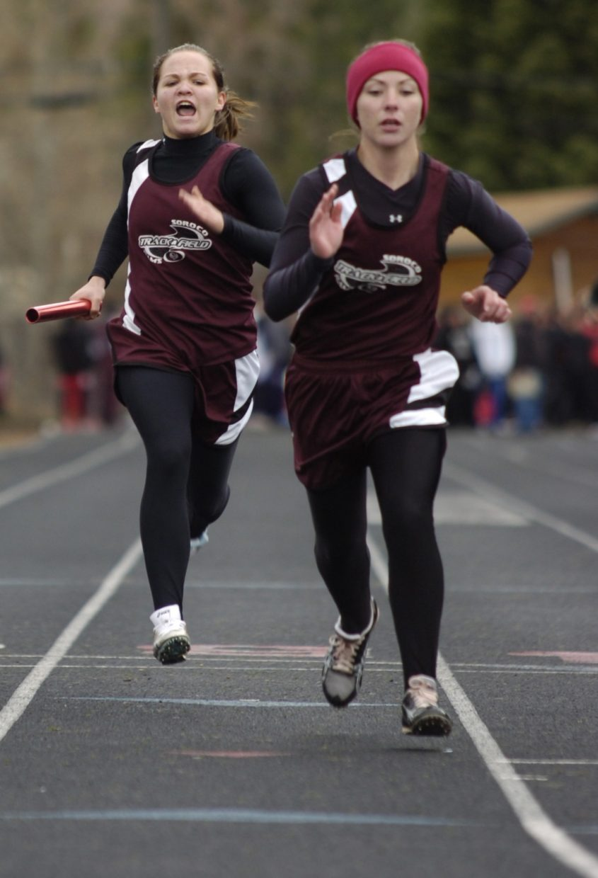Soroco High School's Lauryn Bruggink calls out to Traci Schlegel during the 1,600-meter relay race at Saturday's track meet in Glenwood Springs. The team finished second in the event.