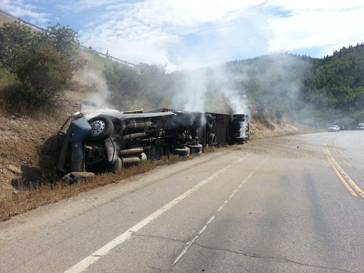 Curt Morlock shared this photo he took of the semitrailer rollover on Rabbit Ears Pass on Sunday. He said he was riding his road bicycle through this corner when this truck passed next to him on two wheels skidding.
