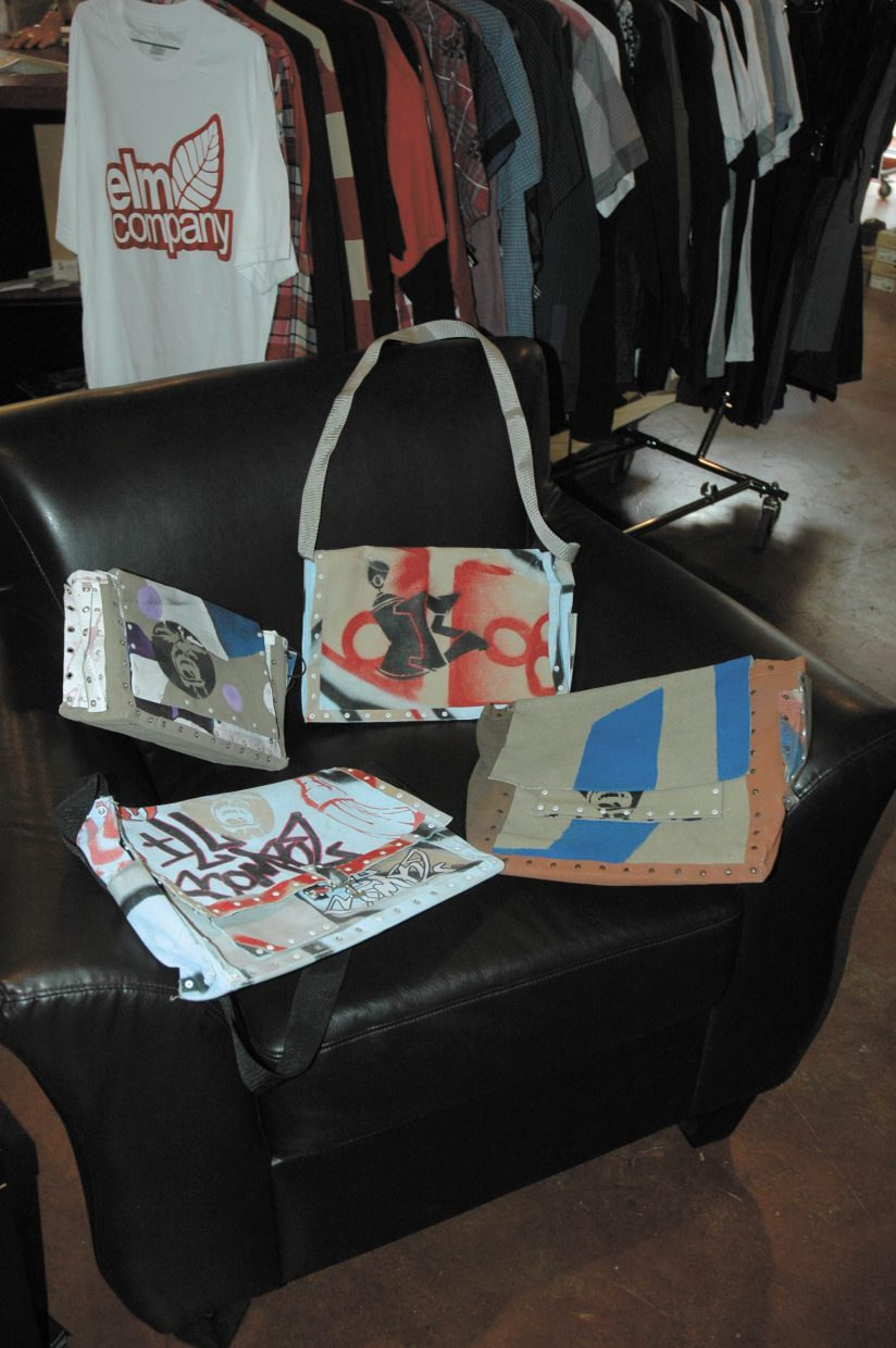 """Pete """"Graffiti Pete"""" Marino makes bags like these out of used art canvasses; he the featured artist for September at Urbane clothing store. A reception for the exhibit is from 5 to 9 p.m. today, and features live music by DJ Also Starring."""